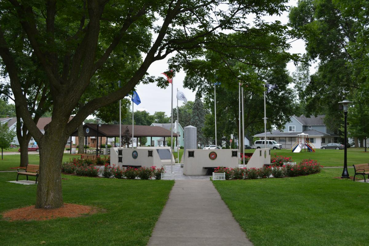 memorials and flag poles in a park