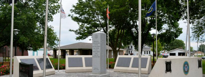 Cuba City memorial with flags